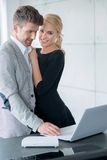 Lovers in Trendy Attire Testing Displayed Laptop Royalty Free Stock Image