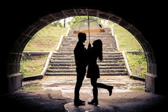 Lovers with umbrella on a rainy day Stock Images