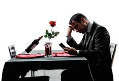 Lovers waiting for dinner silhouettes Royalty Free Stock Photos