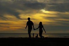 Lovers walk on beach stock photos