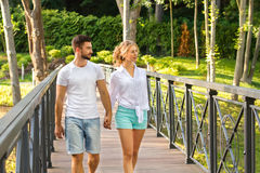 Lovers walk in the park. A date on the bridge in the park. Love story Royalty Free Stock Images