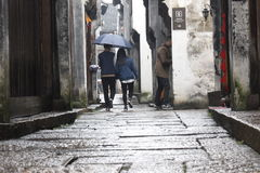 The lovers walking along the Yuehe bystreet Royalty Free Stock Image