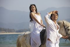 Lovers walking on beach Royalty Free Stock Images