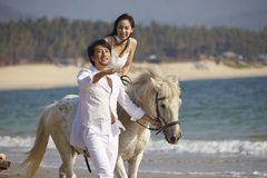Lovers walking on beach Royalty Free Stock Photography