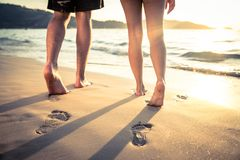 Lovers walking on the beach Royalty Free Stock Photo