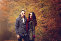 Lovers walking hand in hand in autumn Royalty Free Stock Images