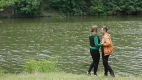 Lovers Walking In Park. Romantic happy young couple walking in nature park stock video footage