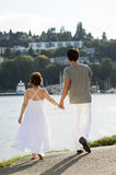 Lovers Walking on Path in Harbor Royalty Free Stock Photo