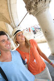 Lovers walking by the streets of Venice. Smiling couple of tourists walking in Venice Stock Photos