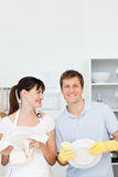 Lovers washing dishes together Royalty Free Stock Image