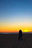 Lovers watch the Sunset at Venice Beach, CA Stock Photos