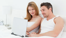 Lovers watching a movie on their laptop Royalty Free Stock Photo