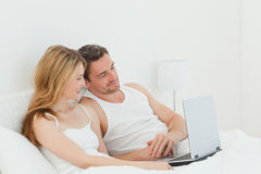 Lovers watching a movie on their laptop Royalty Free Stock Image