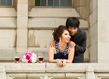 Lovers watching from thier balcony Royalty Free Stock Photography