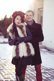 Lovers in the winter. Stylish couple having a walk in the city in winter Royalty Free Stock Image