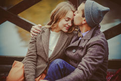 Lovers woman and man sitting near the lake Stock Photos