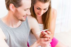 Lovers, woman and man, are happy about positive result of pregna Stock Photos