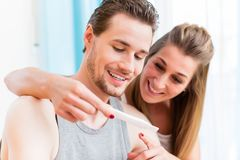 Lovers, woman and man, are happy about positive result of pregna Royalty Free Stock Images