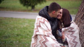 Lovers women and men walk in the park covered with a blanket.  stock video