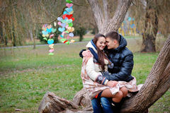 Lovers women and men walk in the park kiss Stock Images