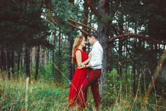 The lovers are in the woods stock photography