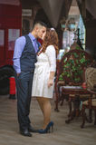 Lovers young guy and girl. The young loving couple embraces and kisses. The girl in a white dress, the men in a vest. Wedding Stock Photo