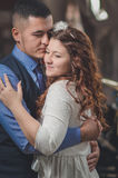 Lovers young guy and girl. The young loving couple embraces and kisses. The girl in a white dress, the men in a vest. Wedding Stock Photos