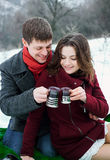 Lovers a young man and a girl drinking tea Royalty Free Stock Photos