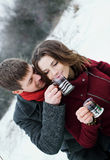 Lovers a young man and a girl drinking tea Royalty Free Stock Image