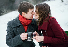 Lovers young man and girl kissing Stock Images