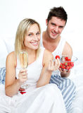 Loves eating strawberries and drinking champagne stock photo