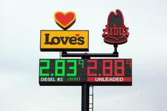 Loves Gas Station travel center and Arby's signs featuring the p. UTAH - JUNE 30: Loves Gas Station travel center and Arby's signs featuring the price of gas Royalty Free Stock Image