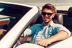 He loves his convertible. Royalty Free Stock Photo