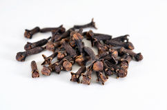 Сloves (spice). The buds fragrant cloves on a white background Royalty Free Stock Photo