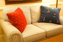 Loveseat. With pillows royalty free stock photo