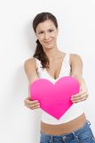Lovesick woman smiling happily with paper heart Royalty Free Stock Photo