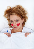 Lovesick woman with thermometer in bed Stock Photo
