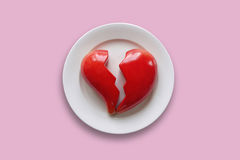 Lovesickness. Plate with broken heart on pink background Royalty Free Stock Image