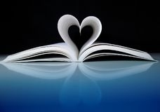 Lovestory. Heart shape with pages of book Stock Images