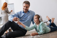 Loving admirable dad playing with his child Royalty Free Stock Images