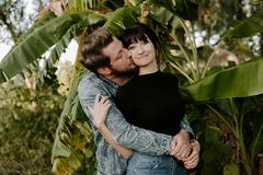 Loving Adorable Portrait of two Attractive Good Looking Young Adult Modern Fashionable People Guy Girl Couple Kissing and Hugging royalty free stock image