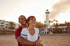 Loving adult couple laughing with happiness Royalty Free Stock Image