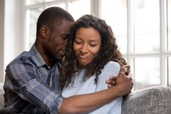 Free Loving African American Husband Embracing Wife After Quarrel Stock Images - 132834184