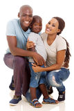 Loving african family. Young loving african american family isolated on white royalty free stock photography