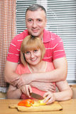 Loving aged couple on the kitchen Royalty Free Stock Photos