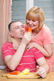 Loving aged couple on the kitchen Stock Photos