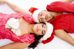 Loving american couple lying down on floor stock photo