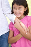 Loving Asain mother and her daughter smiling. Royalty Free Stock Image