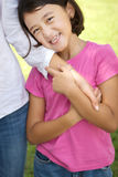 Loving Asain mother and her daughter smiling. Royalty Free Stock Photography