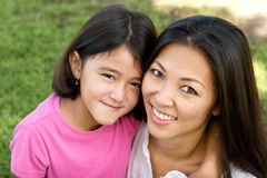Loving Asain mother and her daughter smiling. Royalty Free Stock Photos